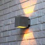 Proof  en væglampe med skærm af beton